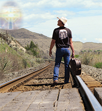 photo of Tom Cole walking on train tracks photo by Margaret Pugh
